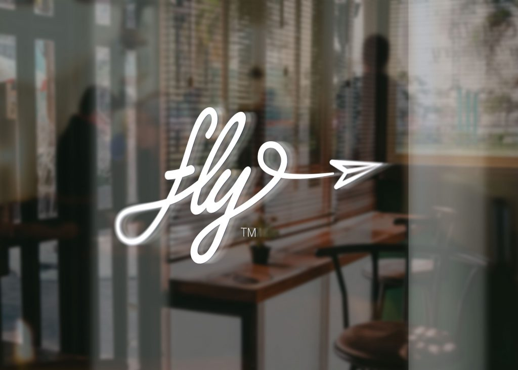 fly! logo decal on a glass office door