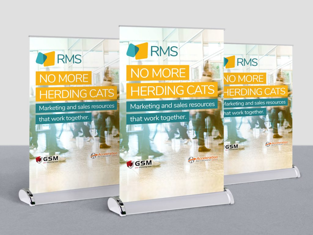 "Small RMS table banners that say ""No more herding cats: marketing and sales resources that work together."""