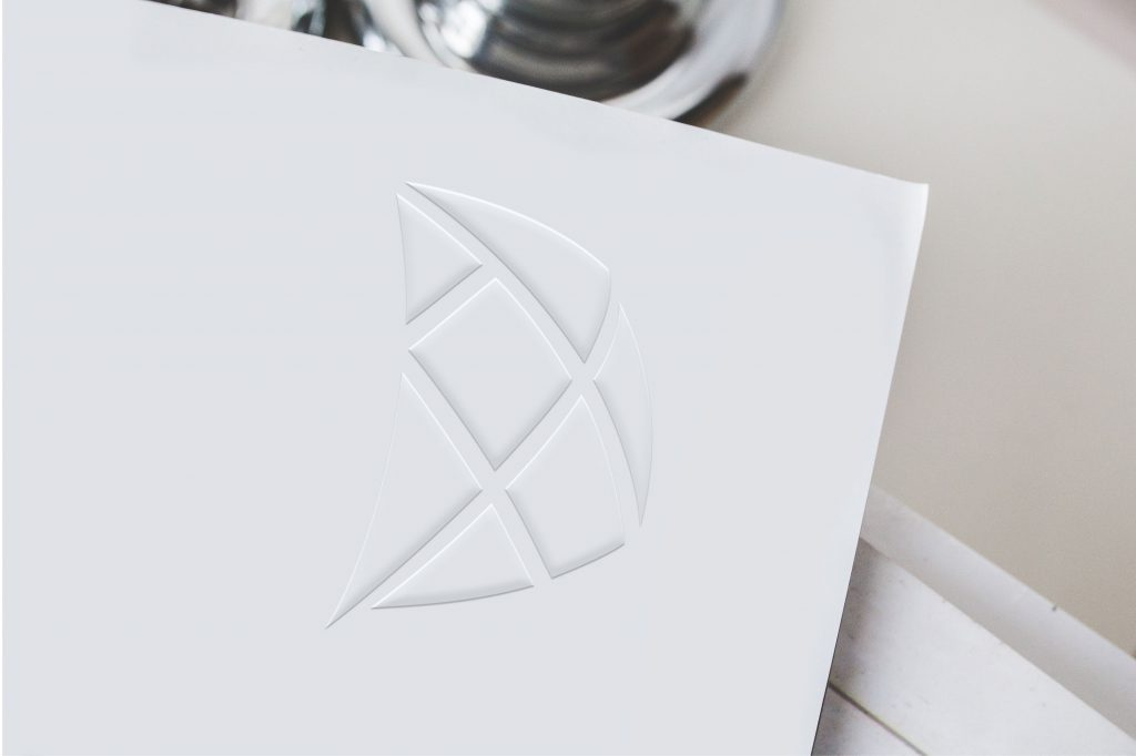 S.I. Group tangram sail icon embossed onto smooth paper