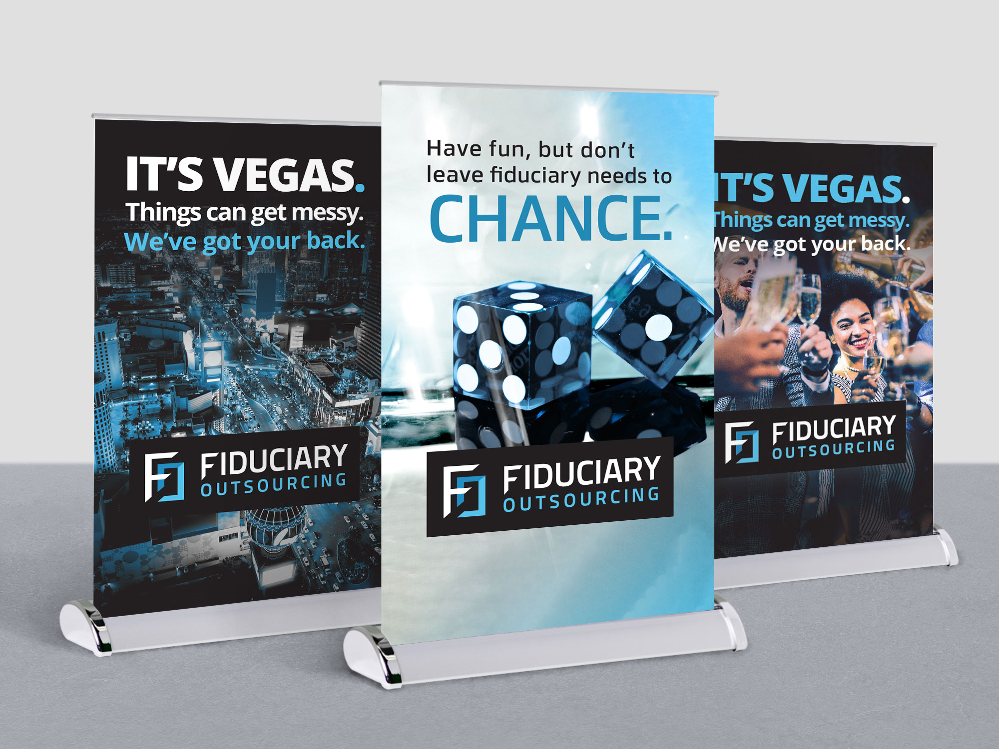 Three small tabletop standing banners with marketing messages customized to a trade show event in Vegas