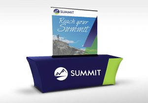 Summit trade show resources: an elastic, branded table cover and a large tabletop banner