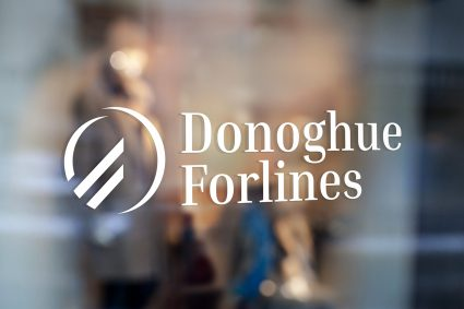 White Donoghue Forlines logo decal on a window