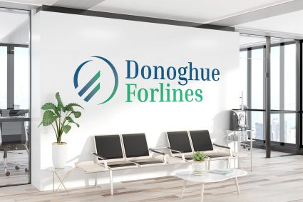 Large Donoghue Forlines logo decal on a wall in an office building