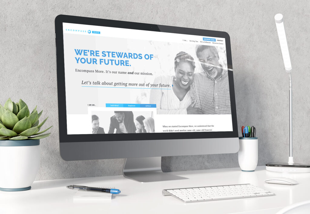 Photo of the Encompass More website displayed on a large desktop computer