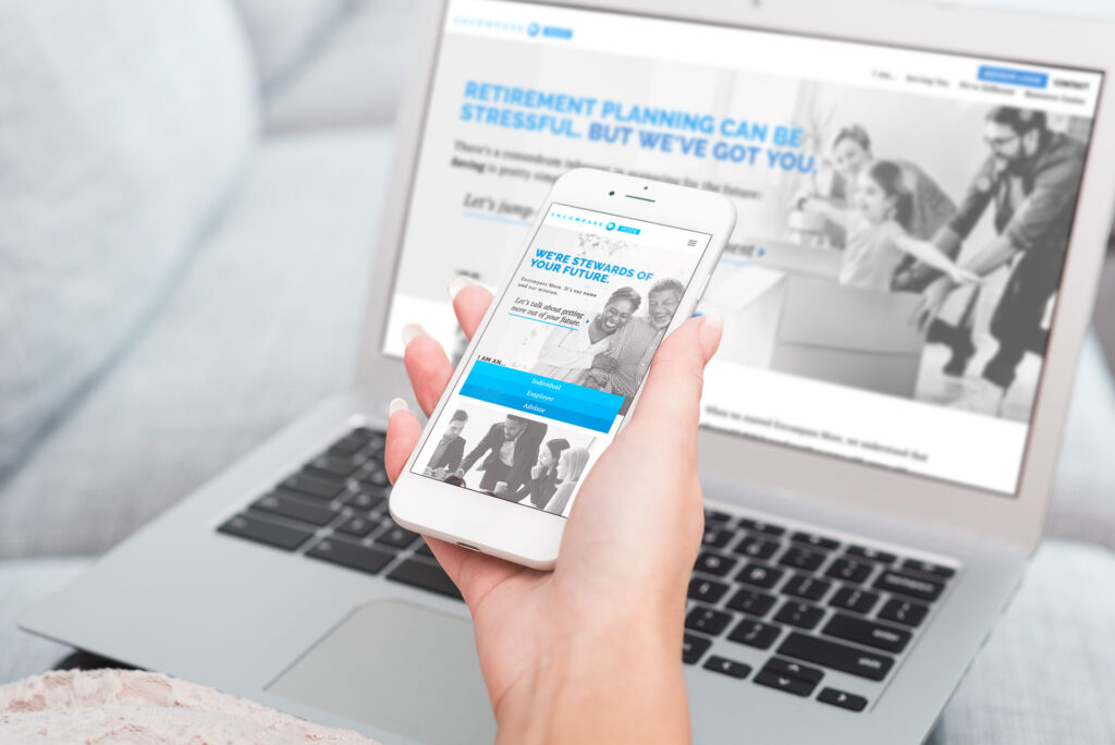 Photo of the Encompass More website displayed on a laptop and a smartphone