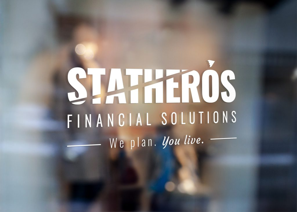 White Statheros logo decal on a glass office door
