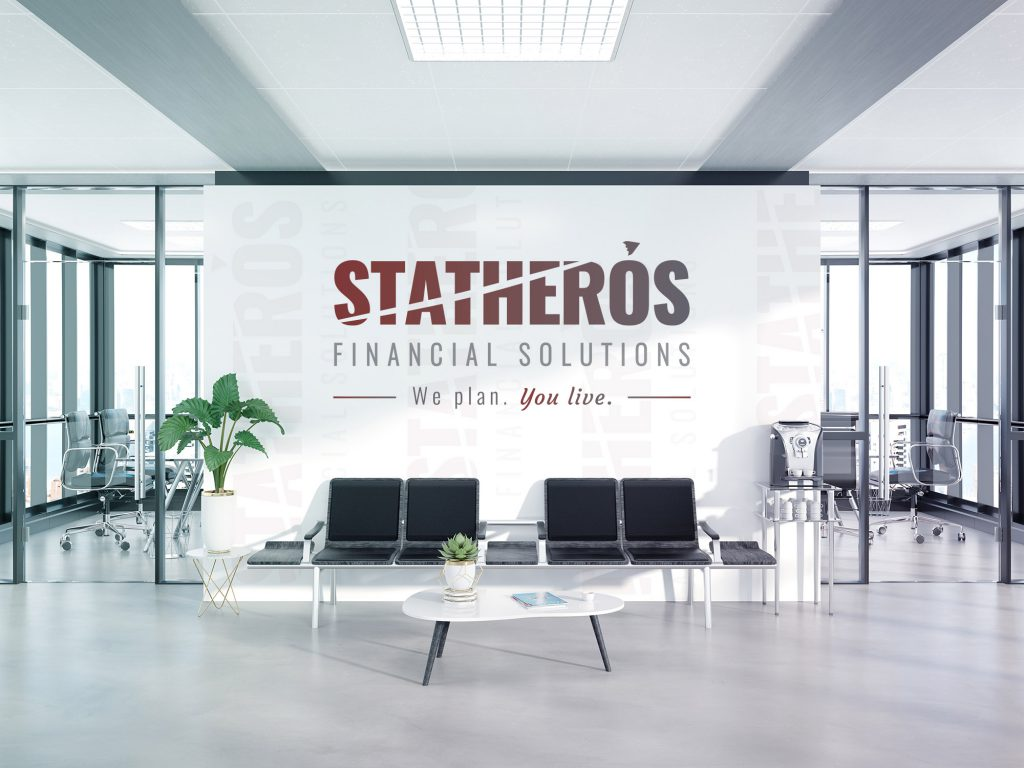 Large Statheros logo decal displayed on a white office wall